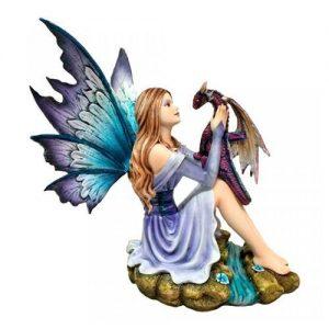 Figura de hada y dragón basilisco