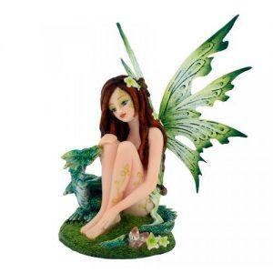 Figura hada y dragón verde