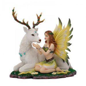 Figura hada y ciervo blanco